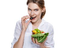 Seductive european woman & vegetable salad - isolated on white background Royalty Free Stock Photography