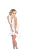 Seductive fashion blonde model posing holding her dress Stock Photo