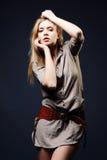 Seductive fashion portrait of young woman on dark Stock Image