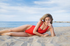 Seductive female in swimsuit rest after swimming Royalty Free Stock Photography