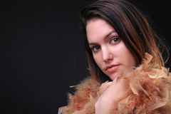 Girl with a feather scarf royalty free stock photo