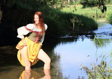 Seductive girl in historical dress in water Stock Image