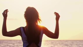 Seductive girl with long hair standing on shore enjoying nature during sunset on the beach in slow motion. Happiness. Concept. 1920x1080, hd stock footage