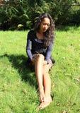 Seductive girl on meadow Stock Photography