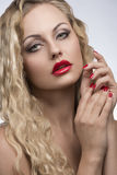 Seductive girl with red make-up Stock Photos