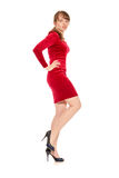 The seductive girl in the red slinky dress Stock Image