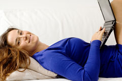 Seductive girl in relax with laptop Stock Photography