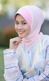 Seductive glance. Beautiful smile of the muslim young girl Stock Image
