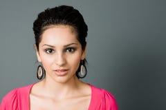 Seductive hipsanic latina. Looks intently stock photography