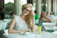 Seductive lady in a drink bar Stock Image
