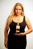 Seductive lady with rum Stock Image