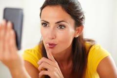 Seductive latin woman chatting on mobile phone Stock Photos