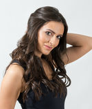 Seductive Latino beauty with hand holding her dark healthy hair Royalty Free Stock Photography