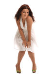 Seductive Look. A seductive brunette in fashionable white dress stock photo