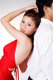 Seductive look. Sexy girl leaning against a gentleman with a sensual seductive look Royalty Free Stock Photos