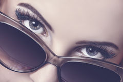 Seductive look over sunglasses Royalty Free Stock Image