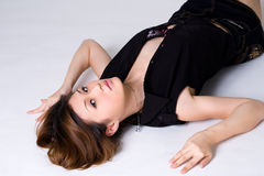 Seductive looks of woman lying on the floor Stock Photos