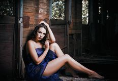 Seductive lovely young woman covered in veil sits in forsaken train wagon. Seductive lovely young woman covered in veil sits in the forsaken train wagon Royalty Free Stock Photo