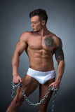 Seductive male model with perfect tattooed body Royalty Free Stock Photo