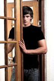 Seductive man in doorway Stock Images