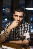 Seductive man in restaurant looking at camera Stock Photography