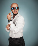 Seductive man in sunglasses and white shirt with beard looking a Stock Images