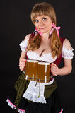 Seductive Oktoberfest with beer in hand Stock Images