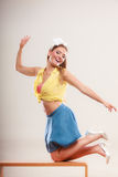 Seductive pin up woman girl dancing on table. Royalty Free Stock Photos