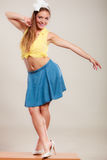 Seductive pin up woman girl dancing on table. Royalty Free Stock Photography