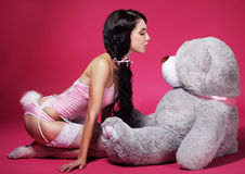 Seductive Playful Woman in Pink Lingerie with Teddy Bear Royalty Free Stock Photo