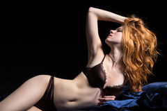 Seductive red-hair girl in a bed Royalty Free Stock Photo