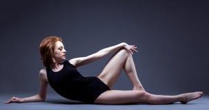 Seductive redhead slim model lying in studio. Image of seductive redhead slim model lying in studio Royalty Free Stock Photo