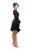 Seductive sensual Latin woman in black dress posing and looking at camera. Stock Images