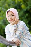Seductive smile. Beautiful smile of muslim young girl at the park Royalty Free Stock Photo