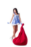 Seductive Snow Maiden posing with big bag of gifts Royalty Free Stock Photography