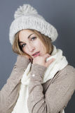 Seductive trendy warm winter. Trendy warm winter - sexy young blond girl getting warmer with white wool winter scarf and hat enjoying softness and comfy fashion Stock Photos