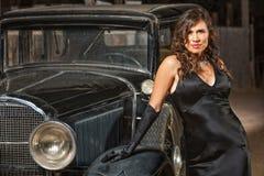 Seductive Woman by Antique Car Stock Photo