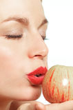 Seductive woman with an apple. Woman with closed eyes kissing an apple Royalty Free Stock Photography