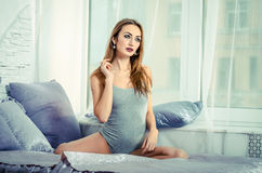 Seductive woman on the bed Royalty Free Stock Photography