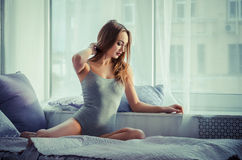 Seductive woman on the bed Stock Photo