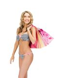 Seductive woman in bikini with shopping bags Stock Photos