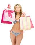 Seductive woman in bikini with shopping bags Royalty Free Stock Photo