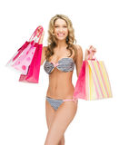 Seductive woman in bikini with shopping bags royalty free stock image