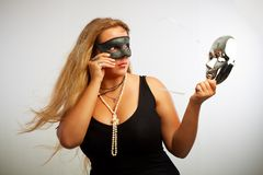 Seductive woman in black mask Stock Images