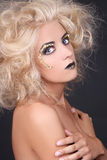 Seductive woman with blondie shaggy hair and creative makeup Stock Photos