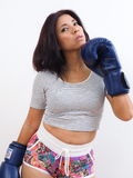 Seductive woman with blue boxing gloves. Attractive Asian woman wearing blue boxing gloves Stock Photo