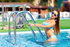 Seductive woman coming out of pool Royalty Free Stock Photos