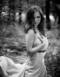 Seductive woman in a dress made of cloth in forest. Model Royalty Free Stock Photos