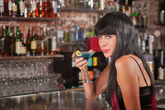 Seductive Woman Drinking Royalty Free Stock Image