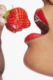 Seductive Woman Eating Strawberry Stock Photos